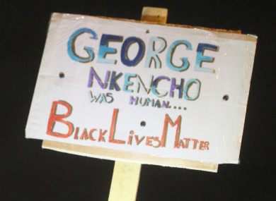 A poster held for George Nkencho during a candlelit vigil outside Blanchardstown Garda station