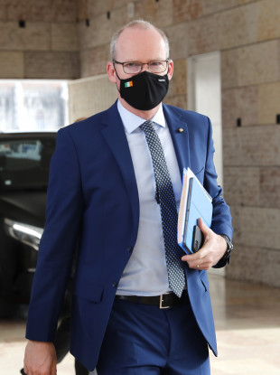 Simon Coveney arrives for a meeting of EU foreign ministers in Lisbon.