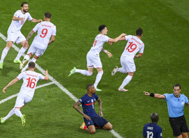 Swiss players celebrate.