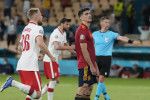 Spain's Gerard Morena, centre right, reacts after missing a penalty.