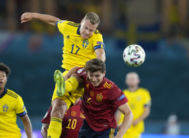 Sweden's Viktor Claesson, left, challenges with Spain's Pau Torres during the Group E match.