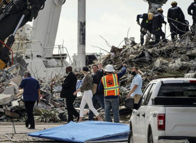 Gov Ron DeSantis tours the site of the rubble while people pass through the memorial wall to pay their respects.