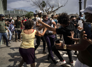 Violence breaks out as Cuban police attempt to arrest an anti-government protestor.