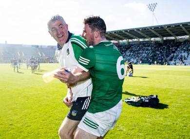 John Kiely celebrated afterwards with winning captain Declan Hannon.