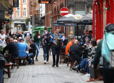 People drinking and dining outdoors in Dublin today.