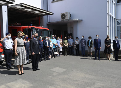 Belgium's King Philippe and Queen Mathilde stand with victims and emergency workers during one minute of silence.