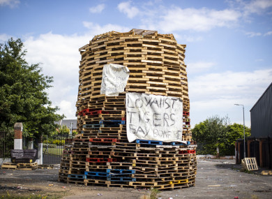 A controversial loyalist bonfire built at the interface in north Belfast dividing loyalist Tigers Bay and nationalist New Lodge (Liam McBurney/PA)