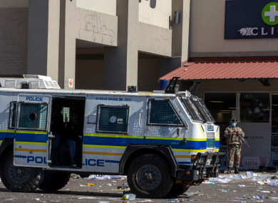 Soldiers patrol and police at a shopping centre in Soweto
