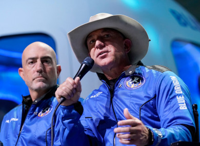 eff Bezos (right) and brother Mark at a news conference after their Blue Origin space flight.