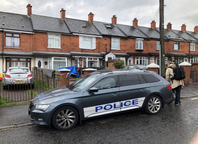 Police at the scene in Brompton Park, Belfast, where a baby died and another young child was critically injured.