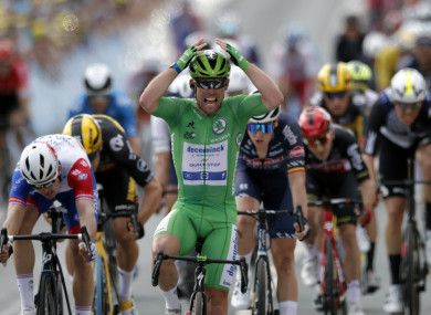 Mark Cavendish reacts after crossing the finish line.