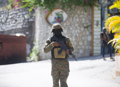 A soldier stands guard in front of Haitian President Jovenel Moise's home in Port-au-Prince.