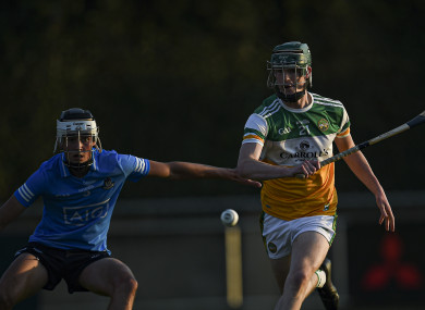 Offaly's Ronan Cleary with Paddy Doyle of Dublin.