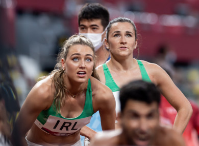 Sophie Becker and Phil Healy watch on anxiously before Ireland's place in the Olympic 4x400m mixed relay final was confirmed.