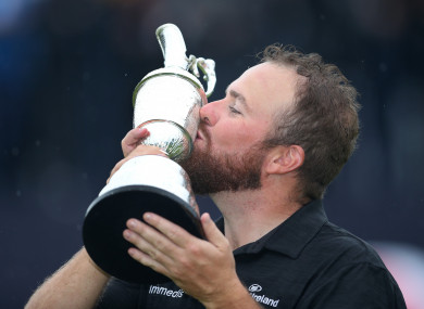 Lowry celebrates with the Claret Jug after winning The Open Championship 2019 at Royal Portrush Golf Club.