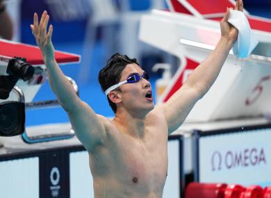 Wang Shun celebrates after the men's 200m individual medley final.
