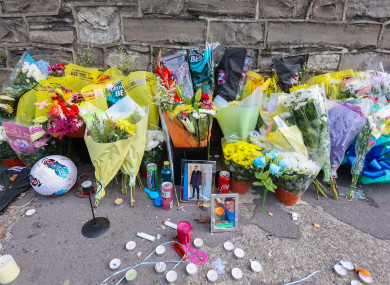 Tributes left by friends and family for teenager Calvin Gilchrist on the Finglas Road in Glasnevin