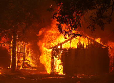 A house is fully engulfed by flames at the Dixie Fire last week.