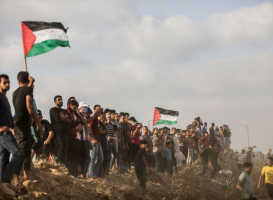 Palestinian protesters during a demonstration near Gaza City on 21 August.