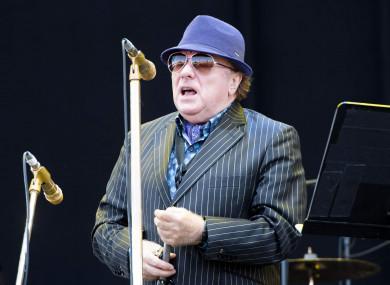 Van Morrison performs on stage.