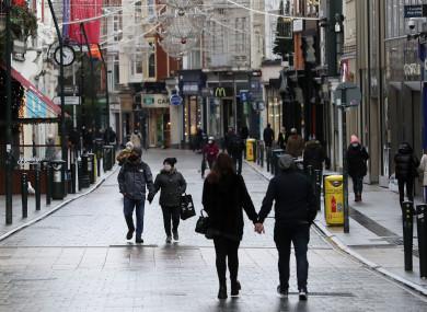 People walk on Grafton street in Dublin's city centre