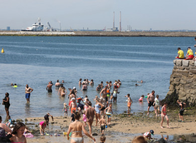 File image of people at Sandycove Beach in Dublin in July.
