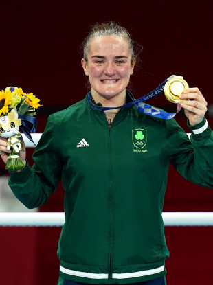 Kellie Harrington celebrating with her gold medal after the women's lightweight boxing Olympic final.