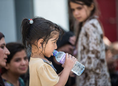 A child drinking water during an evacuation at Hamid Karzai International Airport, in Kabul, Afghanistan.