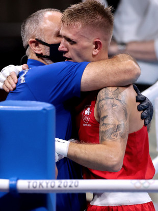 Walsh embraces Walker after he was narrowly beaten by Duke