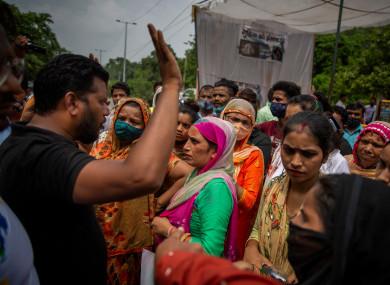 Women protest outside the crematorium in New Delhi.