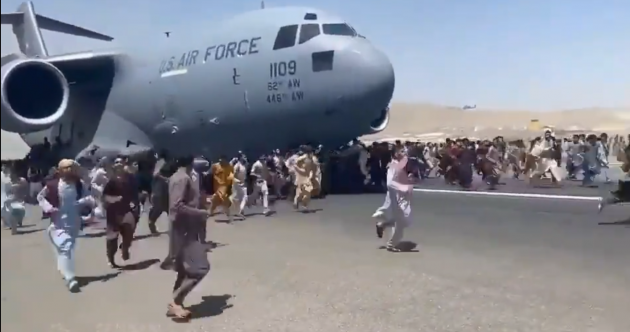 Seven dead at Kabul Airport as videos appear to show people clinging to plane during takeoff