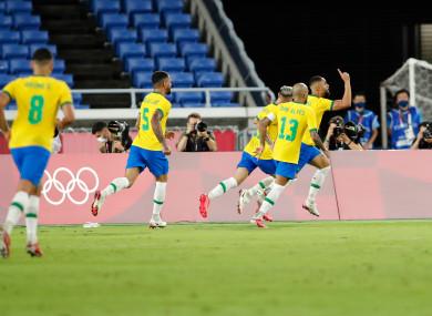 Matheus Cunha celebrates his goal.