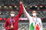 Gold medalists Mutaz Essa Barshim of Qatar and Gianmarco Tamberi of Italy get their gold medals for the men's high jump.