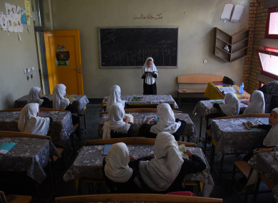 Afghan girls attend a class at a local school in Mazar-i-Sharif, capital of Balkh province, Afghanistan.