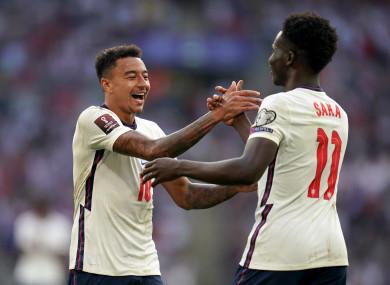 England's Jesse Lingard and Bukayo Saka celebrate after a goal against Andorra.