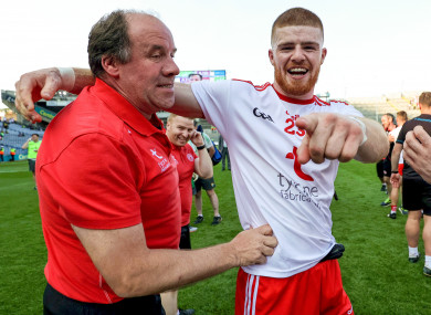 Feargal Logan celebrates with Cathal McShane after Tyrone's win over Kerry.