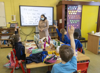 Children and a teacher in their class