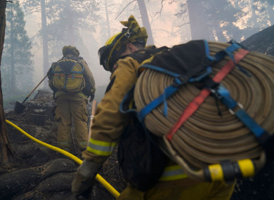 More than 14,600 firefighters were on the lines of 13 active, large wildfires in California