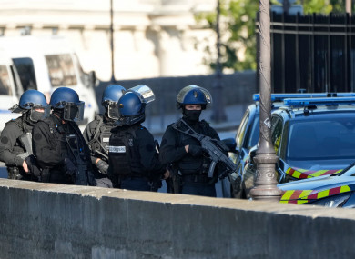 Security forces patrol outside the Palais de Justice in Paris.