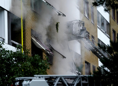 Smoke billows from an apartment building after an explosion in Annedal
