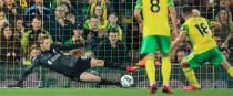 Caoimhin Kelleher saves Norwich's penalty.