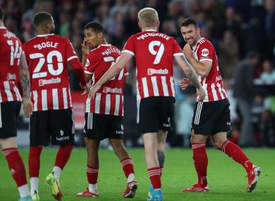 Enda Stevens celebrates scoring for Sheffield United.