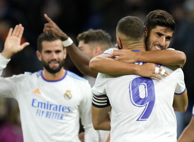 Karim Benzema congratulates Marco Asensio after Real Madrid's fourth goal.