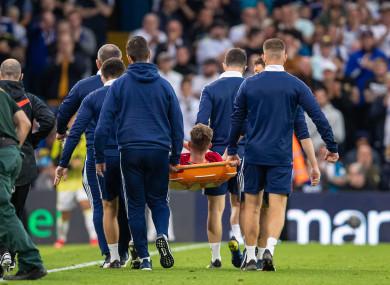 Harvey Elliott leaves the pitch on a stretcher.