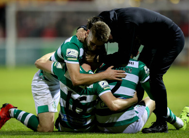Stephen Bradley celebrates Rovers' late winner with Sean Gannon, Dylan Watts and Gary O'Neill.