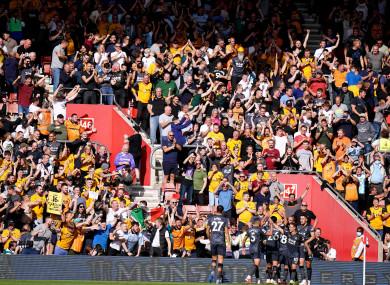 Wolves striker Raul Jimenez celebrates with his team-mates.