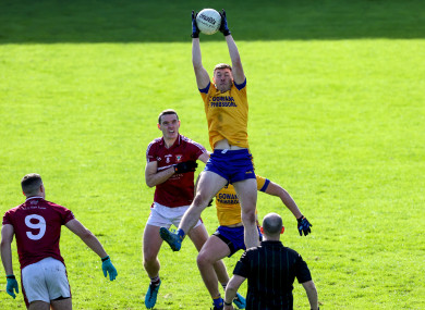 Na Fianna's Alistair Fitzgerald wins the throw-in over Brian Fenton.