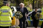 British Prime Minister Boris Johnson, followed by Home Secretary Priti Patel arrive at the scene where David Amess died