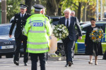 Essex Police chief Ben-Julian Harrington, Labour leader Keir Starmer, Prime Minister Boris Johnson and Home Secretary Priti Patel carry flowers as they arrive at the scene in Leigh-on-Sea where MP David Amess died