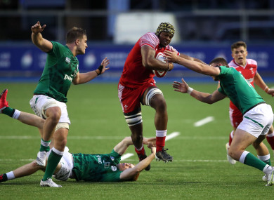 Christ Tshiunza in action for the Wales U20 team.